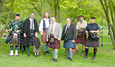 The Army piper in the middle is the only one subject to Dress Regulations. Find your own style and work it!