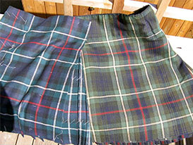 The cloth for these two kilts came from the same mill – but nearly a century of use has faded the one on the right.