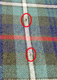 The beginning of the end – kilt-pin holes are not easy to repair.