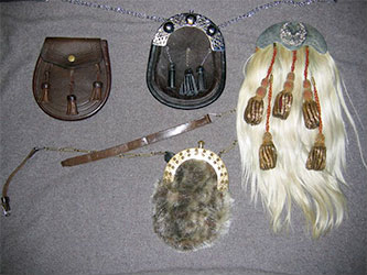 Left to right: a leather 'day' sporran, two 'semi-dress' sporrans, one of sealskin, the other of horsehide, and a military hair sporran of the old 72nd Highlanders.